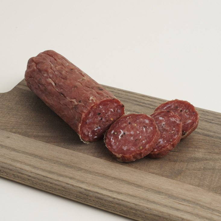 Salami Rustico from Parma Sausage sliced on a cutting board