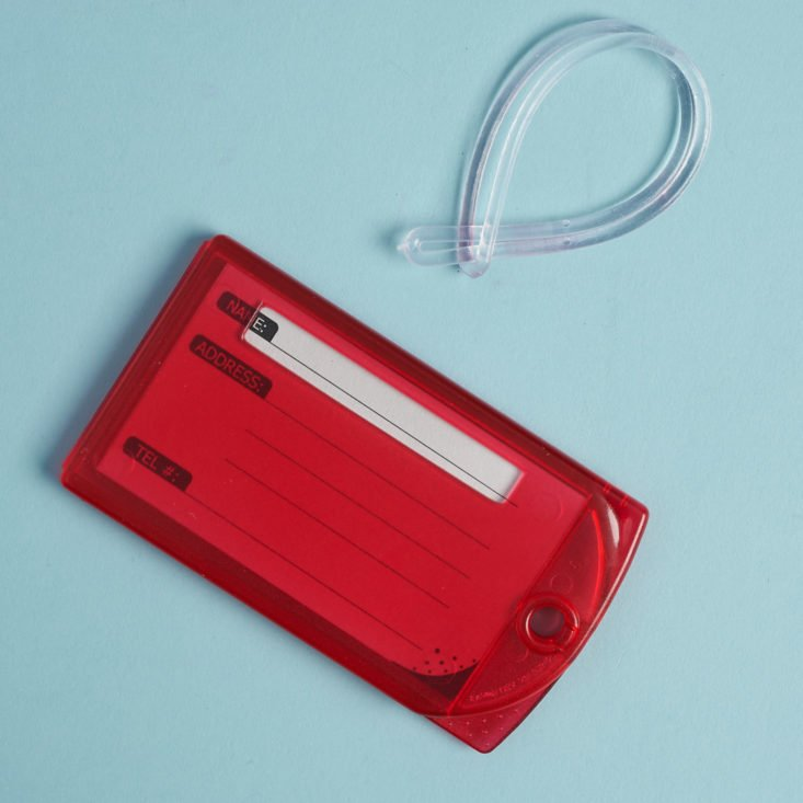 red luggage tag with plastic loop connector