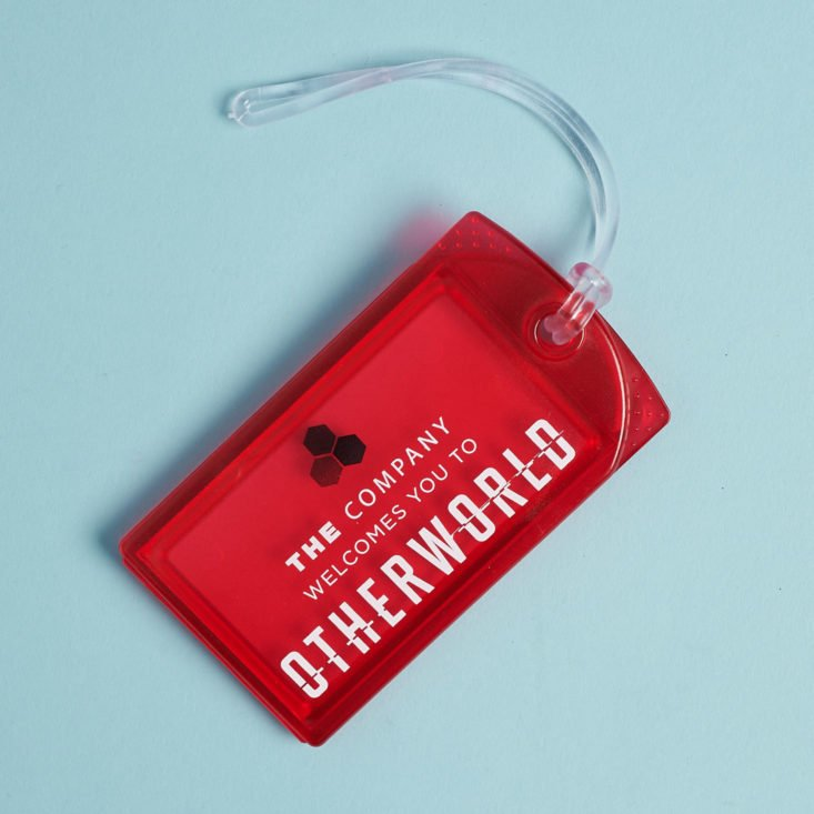 otherworld luggage tag in red