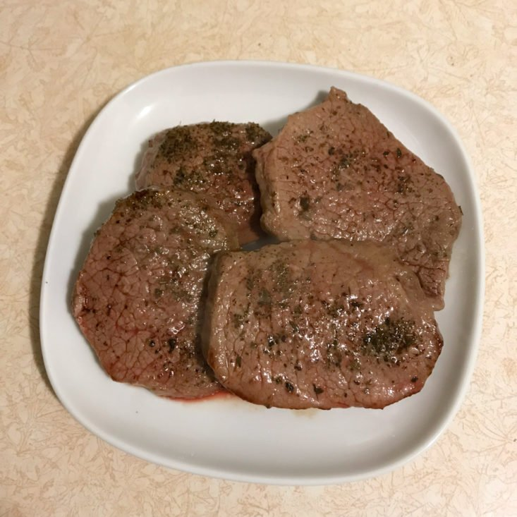 beef medallions resting on plate