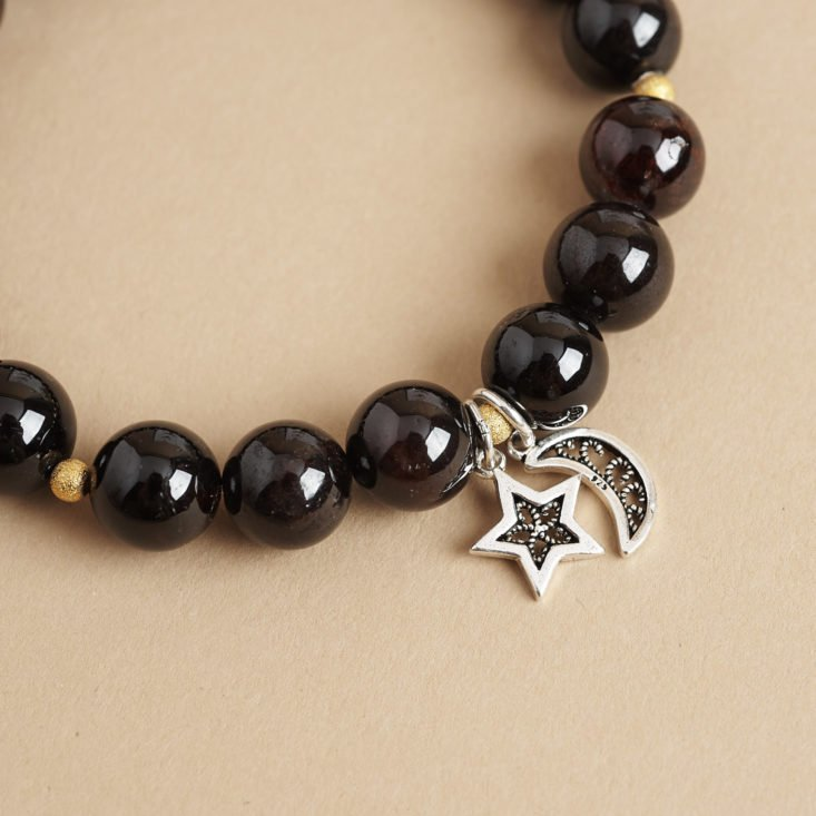 star and moon charm on Wristicuffs garnet and silver charm bracelet
