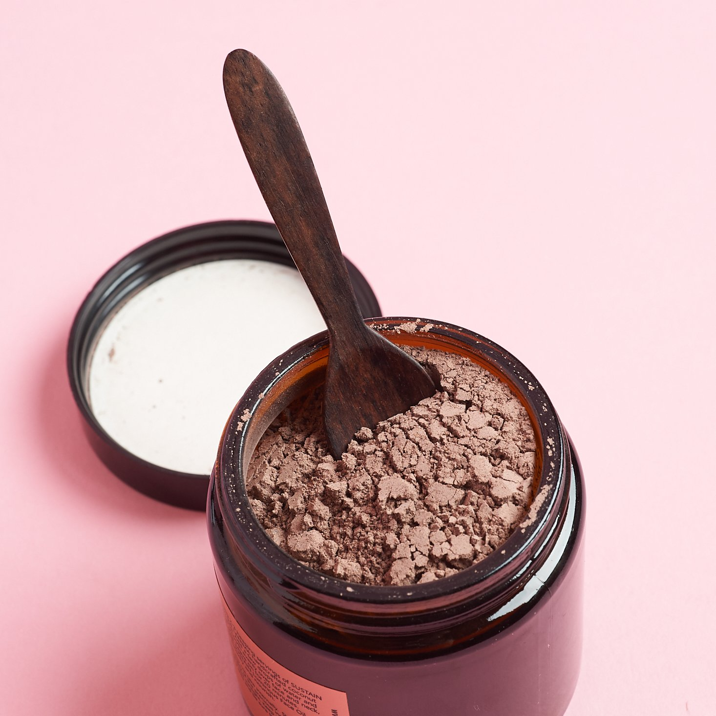 Lanima Skin Sustain Refining Clay Mask with lid off and spoon stuck in powder