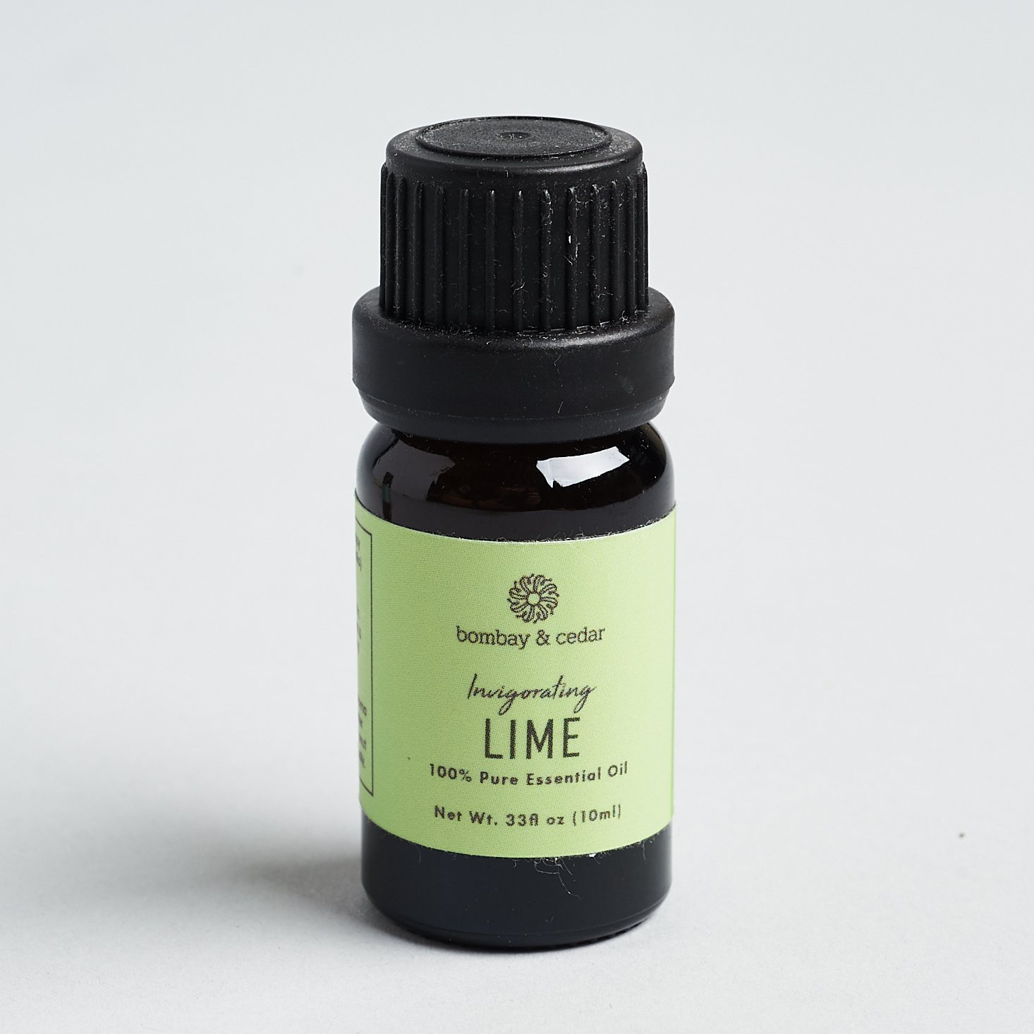 lime oil in amber glass with green label